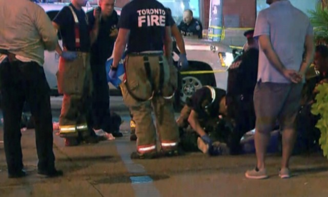 Toronto shooting: woman and attacker dead, 13 others injured