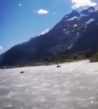 A kayaker in British Columbia's Elaho River narrowly escaped a young grizzly bear that charged at him in the water last Friday.