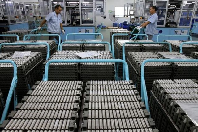 Workers transfer Lithium-ion batteries in a factory in Taizhou in east China's Jiangsu province