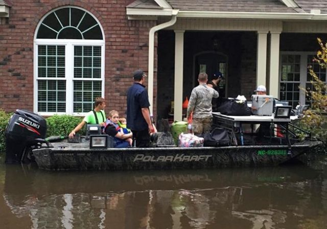 Flood waters rise as Florence pummels Carolinas; at least eight dead