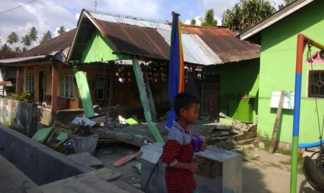 Families reported missing and homes swept away as powerful tsunami hits Indonesia