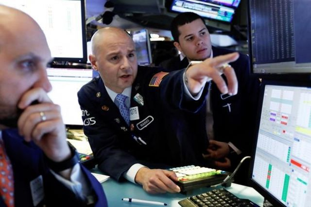 Mario Picone center works with fellow specialists on the floor of the New York Stock Exchange Friday Jan. 4 2019