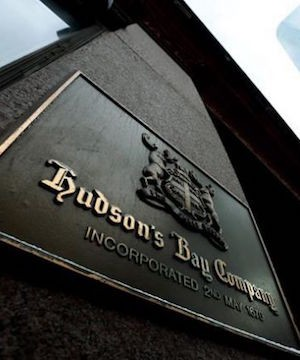 Hudson's Bay board agrees to sweetened privatization offer that values retailer at $1.9 billion.