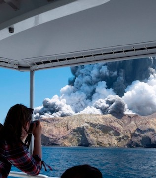 Survivors of a powerful volcanic eruption ran into the sea to escape scalding steam and ash.