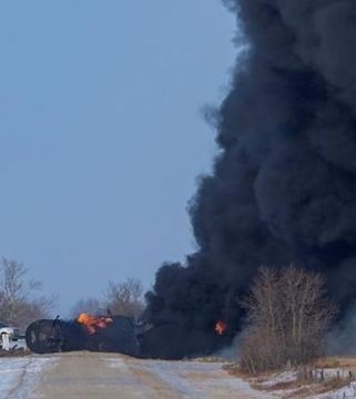 Emergency crews continue to battle a fire that was sparked by derailment of cars carrying crude oil.