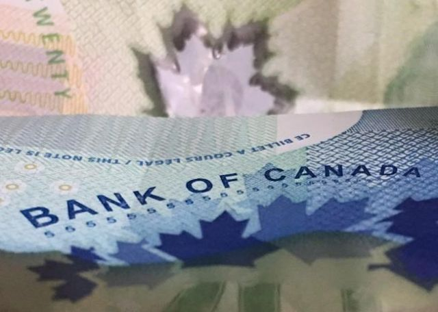Bank of Canada signals extended rate pause, $C drops