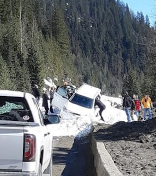 Eyewitnesses report watching an avalanche sweep a car off Highway 1 Sunday near Revelstoke.