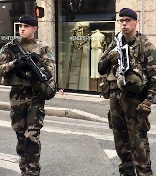 French police are hunting a suspect believed to be responsible for an explosion that wounded 13 people.