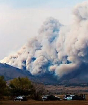 Nearly 3,000 forced to flee fast-moving fire in Colorado, large number of homes believed destroyed.