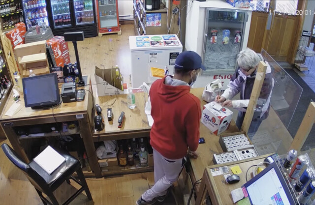 Liquor store employee alleges woman spit on him after refusing to wear mask