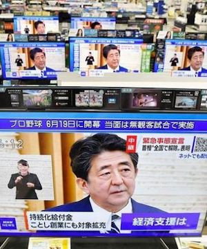 Japanese Prime Minister Shinzo Abe lifts coronavirus state of emergency in last remaining areas.