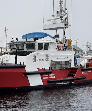 Fisherman's body found, three others missing in sinking off Newfoundland coast.