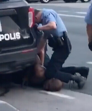 Officer seen kneeling on neck of man who died in custody arrested as violent protests erupt.