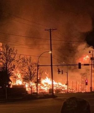 Flames destroy unfinished condo project in Langley, force neighbours to evacuate.